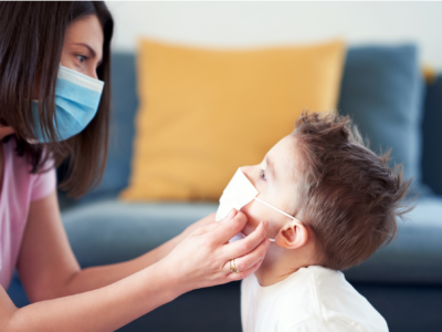mother helping child facemask 2